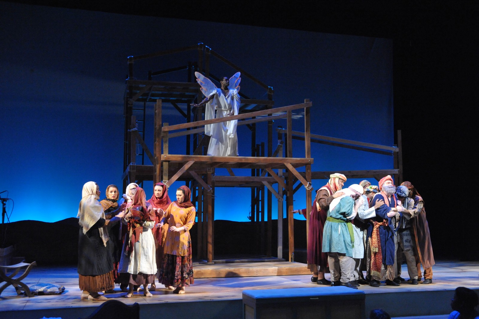 JOSEPH AND THE AMAZING TECHNICOLOR DREAMCOAT - Alan Wiggins as Joseph above the ensemble<br>Set design by Eugenia Furneaux, Lighting by Dan Covey, Costumes by Ivania Stack - photo by Stan Barouh