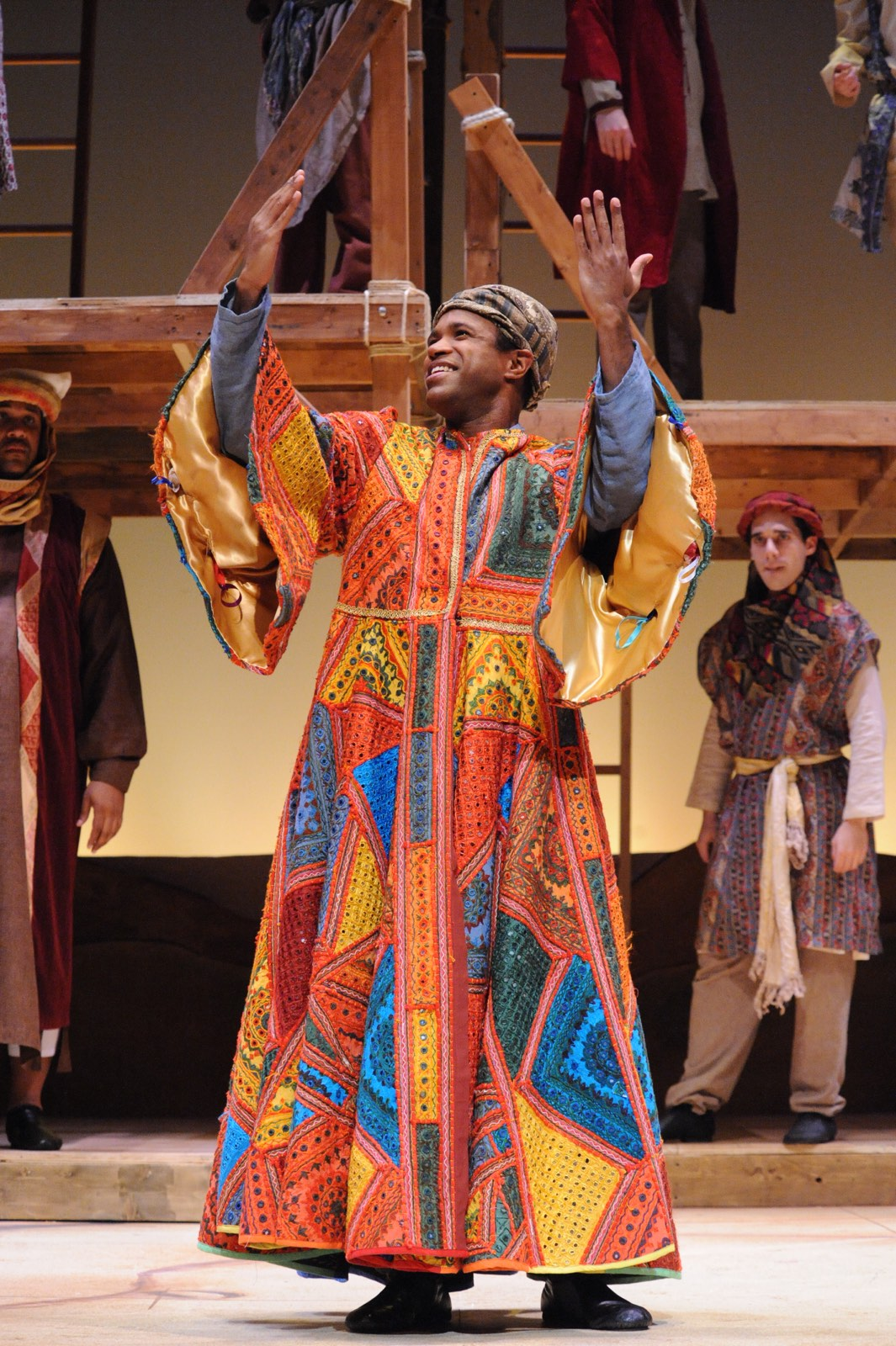 JOSEPH AND THE AMAZING TECHNICOLOR DREAMCOAT - Stephawn Stephens as Reuben, Alan Wiggins as Joseph, and Ben Lurye as Simeon<br>Set design by Eugenia Furneaux, Lighting by Dan Covey, Costumes by Ivania Stack - photo by Stan Barouh