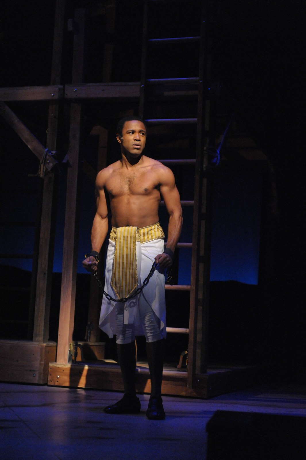 JOSEPH AND THE AMAZING TECHNICOLOR DREAMCOAT - Alan Wiggins as Joseph<br>Set design by Eugenia Furneaux, Lighting by Dan Covey, Costumes by Ivania Stack - photo by Stan Barouh